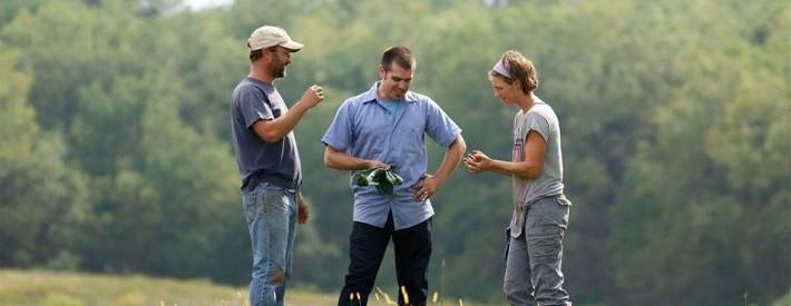 Three People Talking Outside