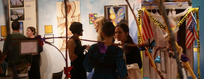 Women Talking at Art Show