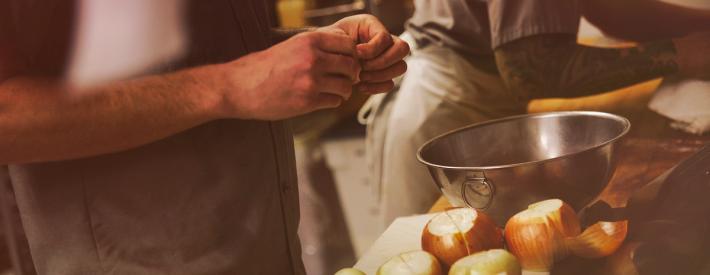 Peeling onions in a kitchen